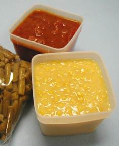 Frozen corn and tomato product