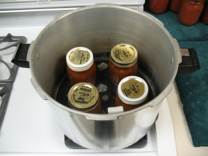 Jars of soup in pressure canner