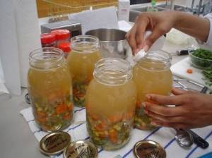 Soup filled jars half and half