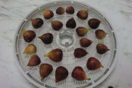 Fresh fig halves on dryer tray
